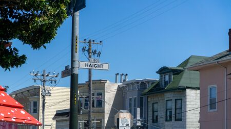San Francisco, USA - August 2019: Haight and Shrader street signs in San Francisco on a summer day