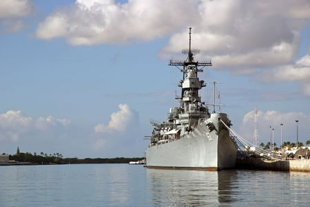 Battleship Missouri Memorial at Pearl Harbor in Honolulu on the island of O'ahu. Japan surrendered aboard the deck to end WW2. Stock Photo - 404383