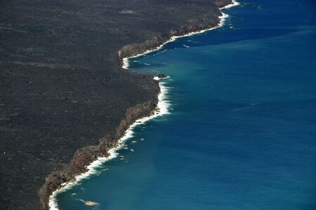 Hardened lava coastline of Hawaii Volcanoes National Park (view from helicopter tour) photo