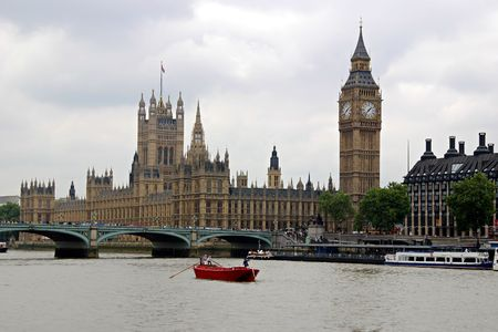 A view of the English Houses of Parliament, Big Ben, Westminster Bridge, and Thames River. (London, England)