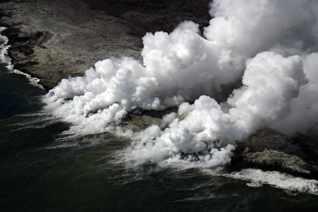 Kilauea lava flow enters ocean. Fourty-four acres of the volcanic shelf pictured collapsed into the ocean five days later on Nov. 28, 2005. (Hawaii Volcanoes National Park)