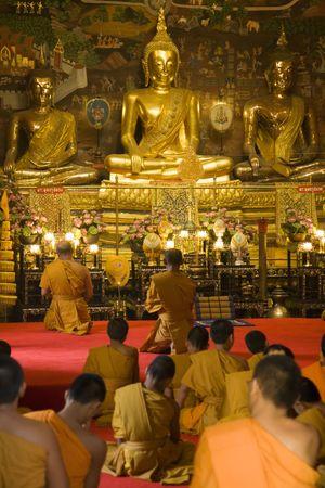 Monks worshipping at Wat Phanan Choeng in Ayutthaya near Bangkok, Thailand. photo