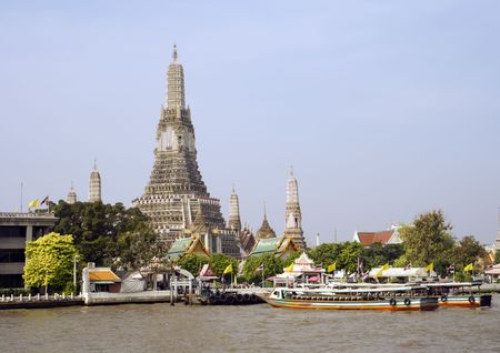 The temple of Wat Arun along the Chao Phraya River in Bangkok, Thailand. photo