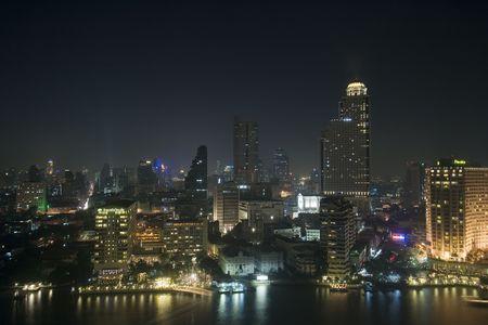 Buildings along the Chao Phraya River in Bangkok, Thailand.