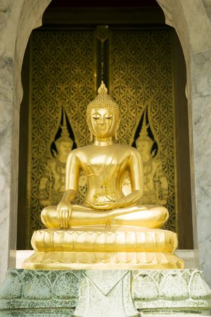 A seated golden Buddha at Wat Trai Mit in Bangkok, Thailand.