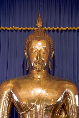 housed: The worlds largest (5-12 tons) solid gold Buddha in Bangkok, Thailand.  Housed in the temple of Wat Trai Mit. Stock Photo