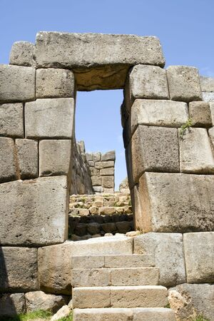 cusco: A stone doorway and staircase in the Incan ruins of Sacsayhuaman in Cusco, Peru. Stock Photo