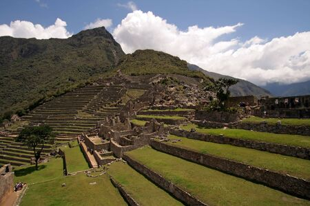 incan: View of terraces and buildings of the lost Incan city of Machu Picchu in Peru. Stock Photo