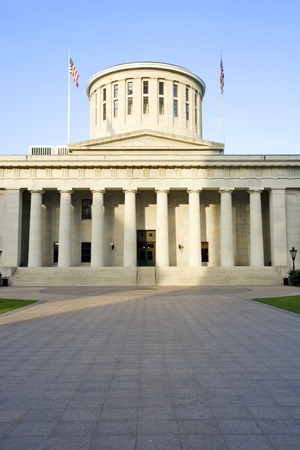 West facade of the Ohio Statehouse in Columbus, Ohio lit by sunlight.