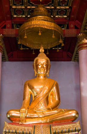 seated: Seated gold Buddha statue in Buddhist temple in Ayutthaya near Bankgok, Thailand. Stock Photo