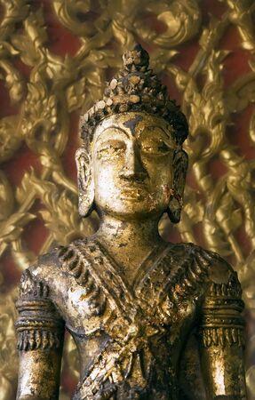 awakened: Golden Buddha statue at Buddhist temple in Ayutthaya near Bangkok, Thailand. Stock Photo