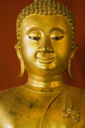 awakened: Authentic Buddha statue in a Thai temple. Stock Photo