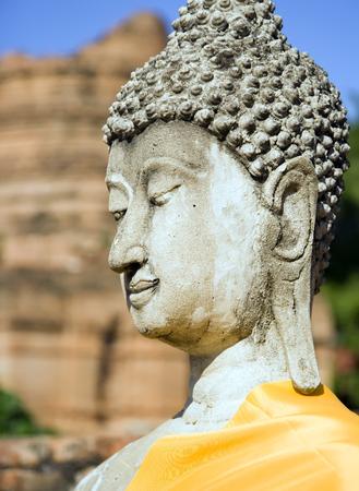 buddha image: Stone Buddha at Wat Yai Chai Mongkol in Ayutthaya near Bangkok, Thailand.