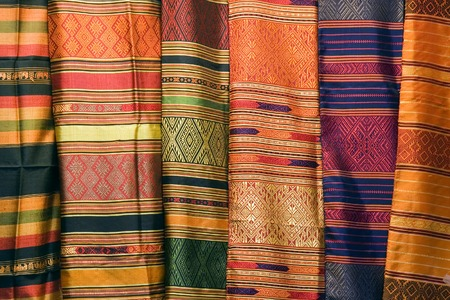 silk fabric: A collection of Thai silk cloths at the weekend market.