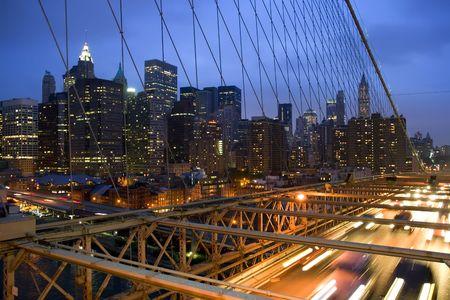 latticework: View of New York City skyline through Brooklyn Bridge latticework. Stock Photo
