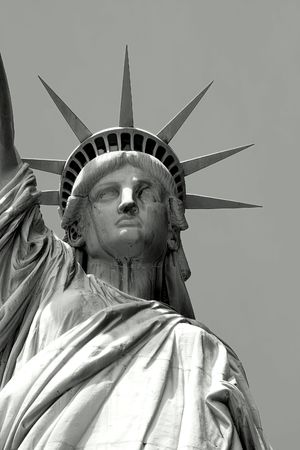 close in: Black and white close up of Statue of Liberty on Liberty Island in New York City.