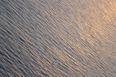 highlight: Abstract textured background with diagonal ripples and golden highlight.