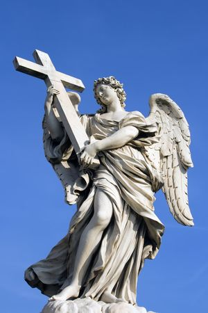 Statue of angel holding cross outside in Rome, Italy. Stock Photo