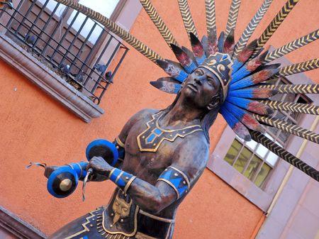 Statue of dancing indian in the colonial city of Queretaro, Mexico. Фото со стока