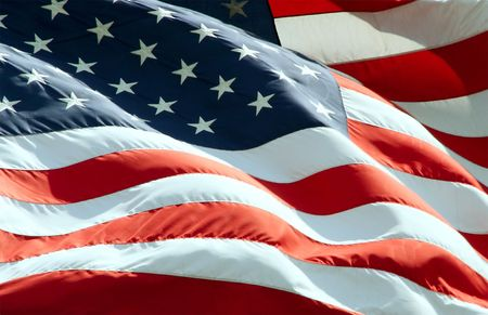 Close up view of American Flag waving in the wind. Stock Photo