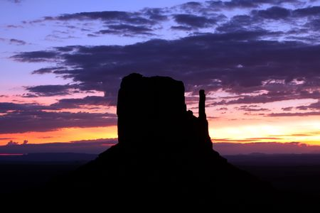 butte: West Mitten Butte at Monument Valley during sunrise.