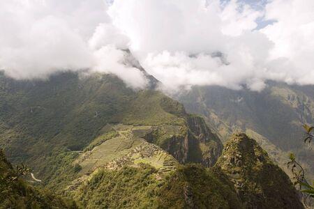 Aerial view of Machu Picchu under cloud cover from the peak of Wayna Picchu near Cusco, Peru. 写真素材