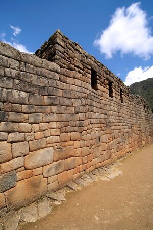 incan: L'Artigiano del muro al rovine Inca di Machu Picchu vicino a Cusco, Per�.