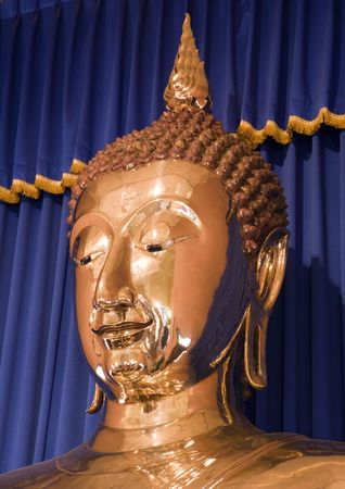 The worlds largest (5-12 tons) solid gold Buddha in Bangkok, Thailand.  Housed in the temple of Wat Trai Mit. photo