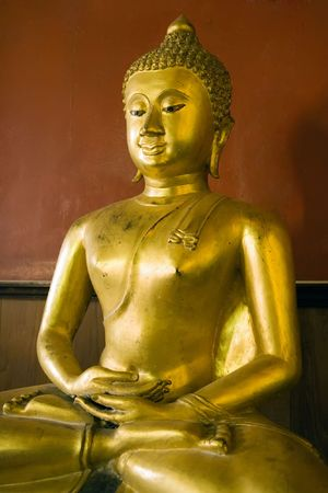 Buddha statue at the Buddhist temple of Wat Phanan Choeng in Ayutthaya near Bangkok, Thailand. photo
