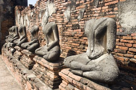Ancient Buddha statues at the ruins of the Buddhist temple Wat Chai Wattanaram in Ayutthaya, Thailand. photo