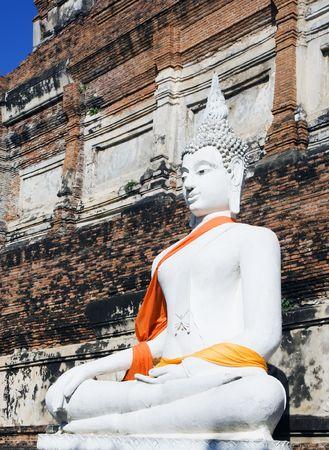 buddha image: Buddha statue at ruins of the Buddhist temple Wat Yai Chai Mongkol in Ayutthaya near Bangkok, Thailand. Stock Photo