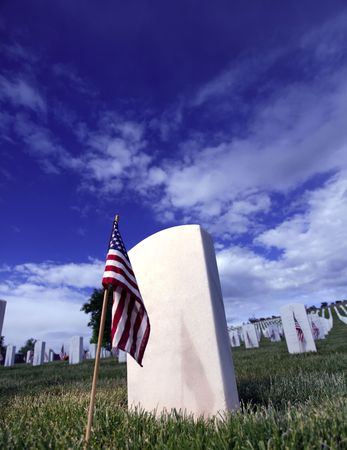 a memorial to fallen soldiers: Grave Marker of soldier in Santa Fe National Cemetery in Santa Fe, New Mexico. Stock Photo
