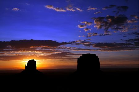 Sunrise over East Mitten Butte and Merrick Butte at Monument Valley on the border of Utah and Arizona. Stock Photo - 5119394