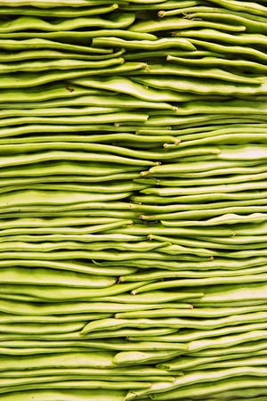 Stack of green beans at public market in Barcelona, Spain. Stock Photo - 5263013