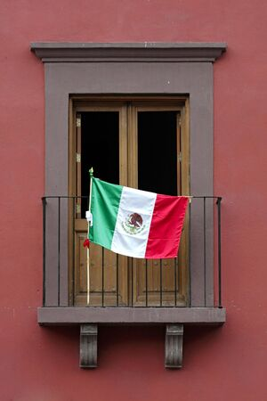 Colorful balcony with Mexican flag in San Miguel de Allende. photo