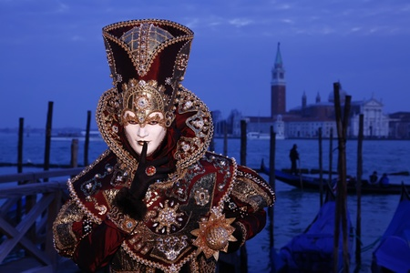 st  marks square: Venice, Italy - March 5, 2011 - An unidentified person in costume in St. Marks Square during the Carnival of Venice on March 5, 2011.  The 2011 carnival was held from February 26th to March 8th.