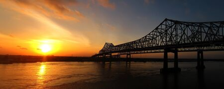greater: The Crescent City Connection (formerly the Greater New Orleans Bridge) at sunrise in New Orleans, Louisiana on April 11, 2011. Stock Photo