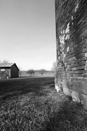 barn black and white: A black and white brick barn side taken in Pennsylvania