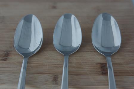 Three empty spoons Imagens