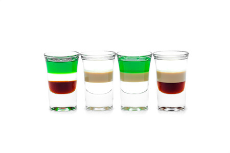 alcoholic drink: Four short Alcoholic drink in a glass