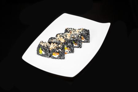 philadelphia roll: sushi rolls set of black rice with salmon, avocado and Philadelphia cheese on a black background