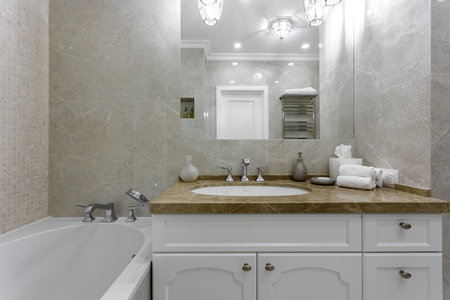 luxury apartment: interior of a modern bathroom with a mirror and sink Stock Photo