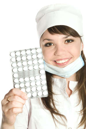 The beautiful girl the nurse holds in a hand a Tablets  close on a white background bsolated Stock Photo - 4981795