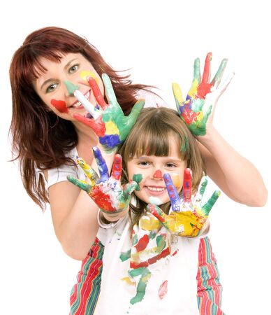 Mother together with a daughter is shown with palms soiled with a paint of different colors, smile photo