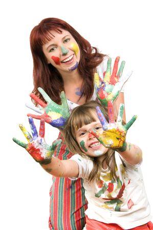 shown: Mother together with a daughter is shown with palms soiled with a paint of different colors, smile
