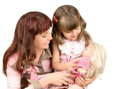 Mother with a daughter play with a toy a doll, smile, on a white background photo