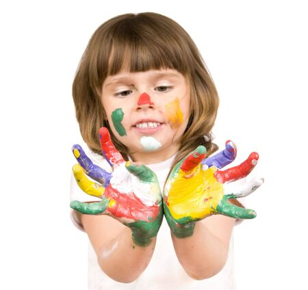 dirtied: The small beautiful girl has stretched to a camera of a palm soiled in a paint of different colors, smiles, closeup, on white background