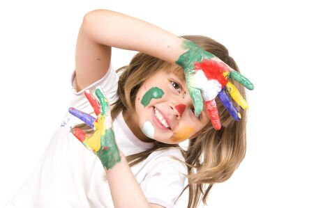 The small beautiful girl has stretched to a camera of a palm soiled in a paint of different colors, smiles, closeup, on white background photo