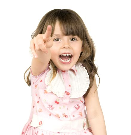 The small beautiful girl is dared, shouts, shows a finger of a hand in a direction of a camera, on white background