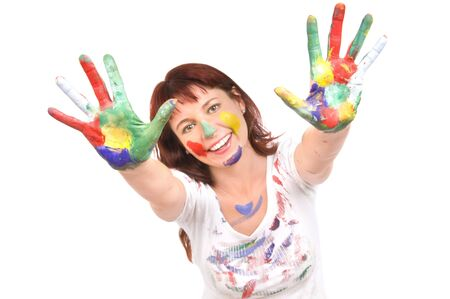 dirtied: The beautiful woman has stretched hands soiled in a paint upwards to a camera, on a white background, smiles Stock Photo